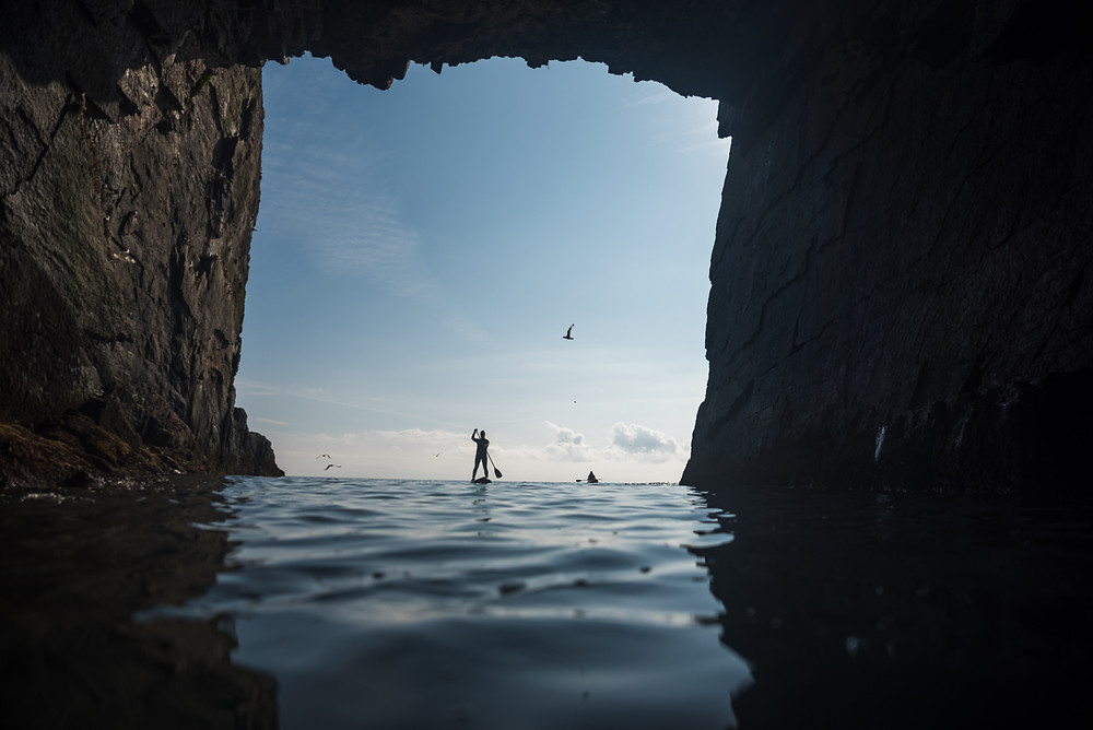 colm keating, man on paddleboard in cave, old head of kinsale,