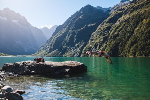 Diving into Lake Marian, Fiordland National Park New Zealand. Colm Keating