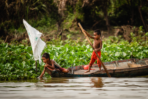 Cambodia children working. Floating villages. Tonle Sap Lake, Cambodia. Colm Keating Photography.