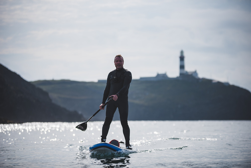 old head of kinsale lighthouse with paddleboarder, colm keating, brendan mcaleer,