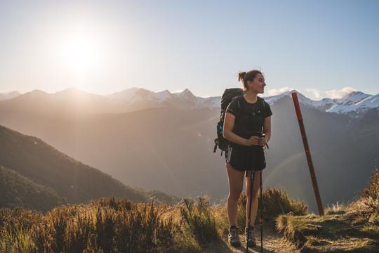 Woman hiking up the ridge below Brewster Hut, New Zealand. Colm Keating