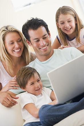 Family laughing at laptop 2.jpg