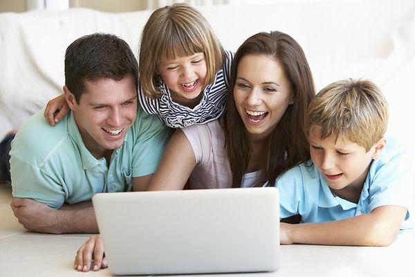 Family laughing at laptop.jpg