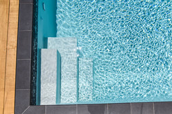 Black mosaic tiles for swimming pool