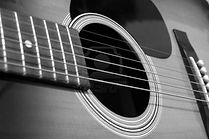 play acoustic and electric guitar with lessons in Leicester