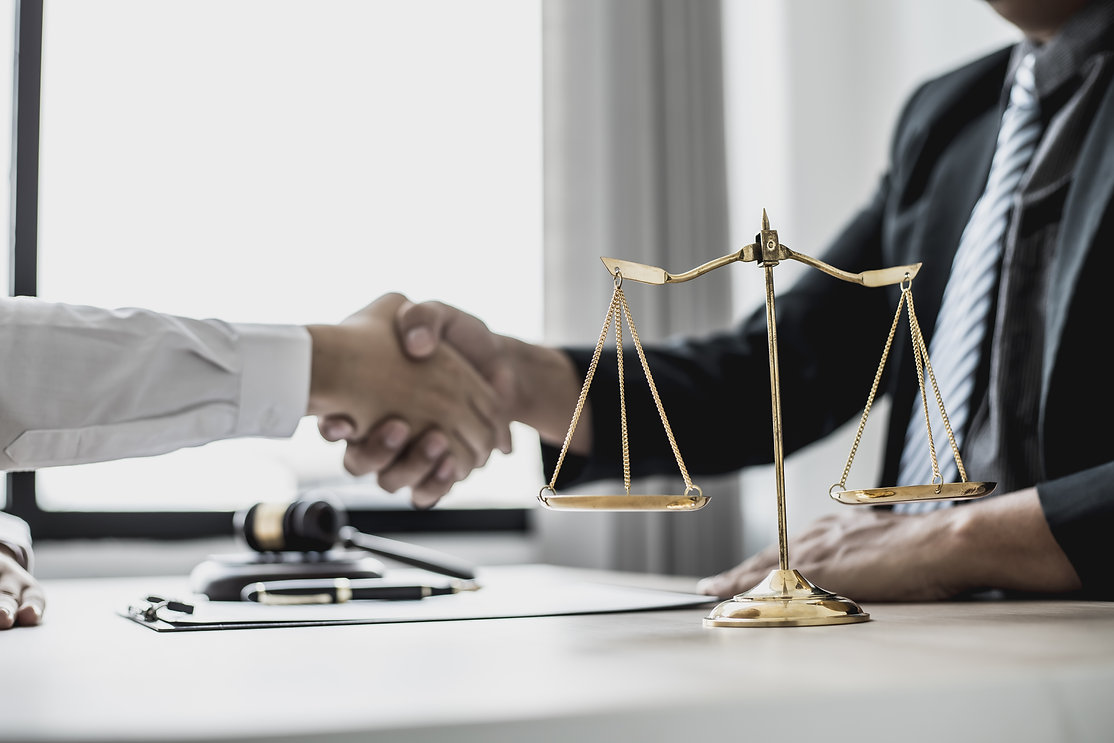 Lawyer and client shake hands, after winning a lawsuit where a lawyer hired by a client in