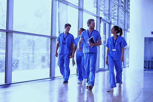 Four%2520healthcare%2520workers%2520in%2520scrubs%2520walking%2520in%2520corridor_edited_edited.jpg