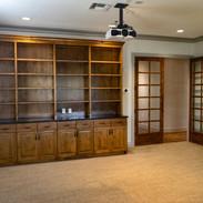 Custom bookshelves with granite countertops