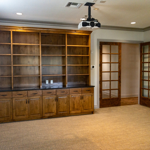 Custom bookshelves with granite countertops