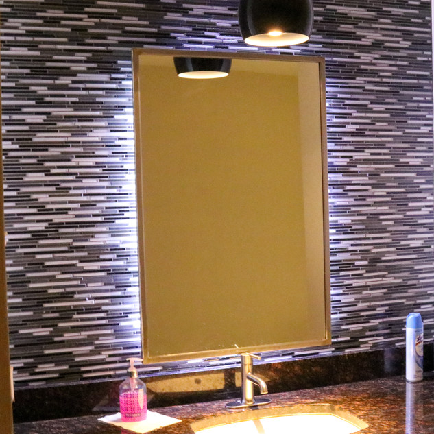 Restroom renovation Glass tile, granite countertops and LED backlit mirror