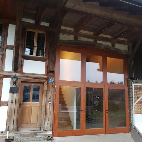 Türfront Tenne-Tor Massivholz gestemmt verglast