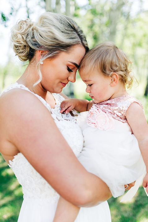 Wedding photo of bride and her young daughter