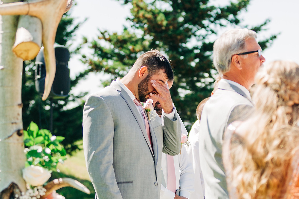 Groom seeing bride walk down the aisle. Groom seeing bride for the first time on wedding day.
