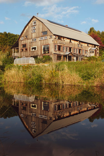 Barn pond with solar panels and greenhou