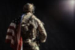 Soldier holding machine gun with nationa