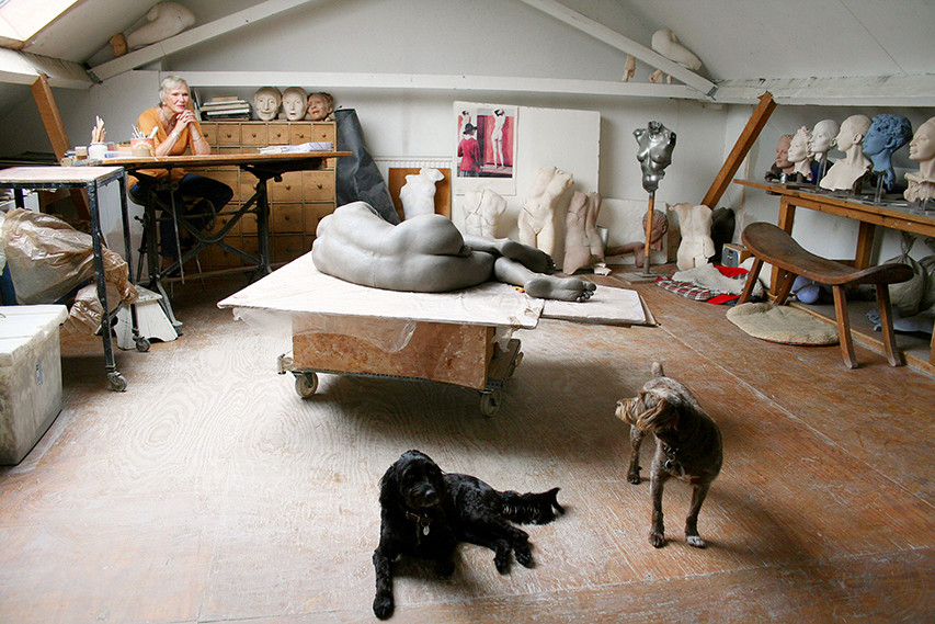 Josie and dogs, in her studio.