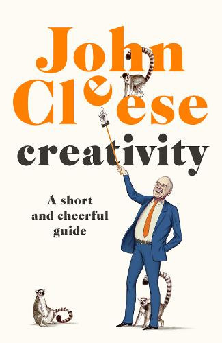 John Cleese the actor stands pointing up at orange coloured letters that say his name and the words Creativity A Short And Cheerful Guide. There are two lemurs around his legs.