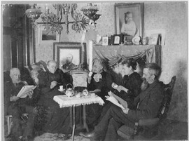Interior of CC Spencer's Parlor 1884. CC Spencer far right.