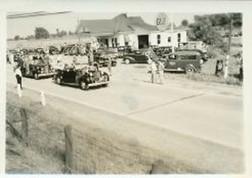 President Franklin Roosevelt's motorcade passes through De Kalb Junction August 1940