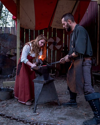 viking woman forging.jpeg