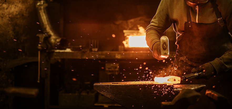 the-blacksmith-forging-the-molten-metal-on-the-anv-2.jpg