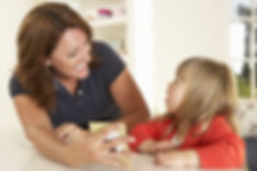 Speech therapist working with litte girl