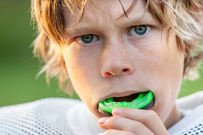 Boy putting in his mouth guard.jpg