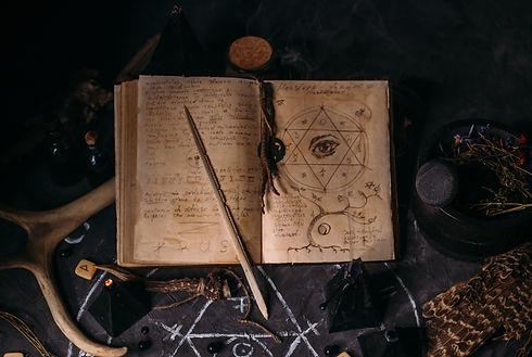 Open old book with magic spells, runes,