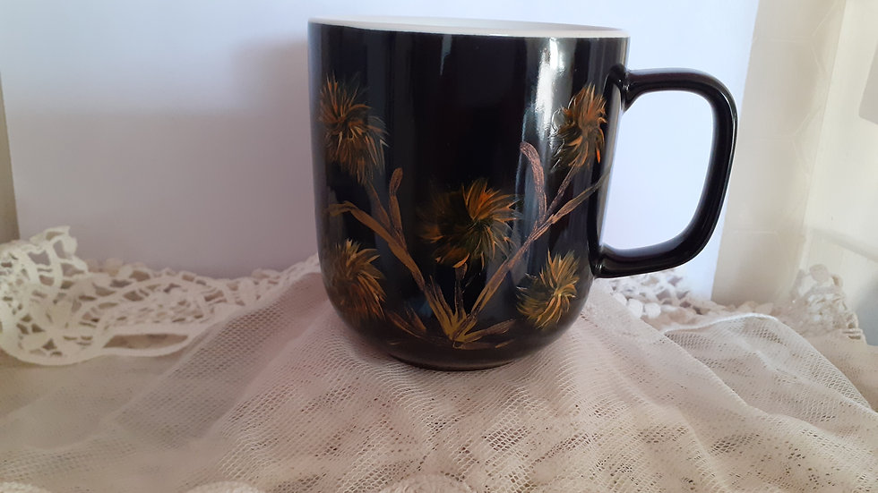 Hand painted black gloss mug p&p inc. Orange and yellow abstract flower deisign