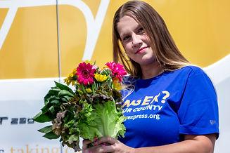 Luisa Holding Food Flowers IMG_8386.jpg