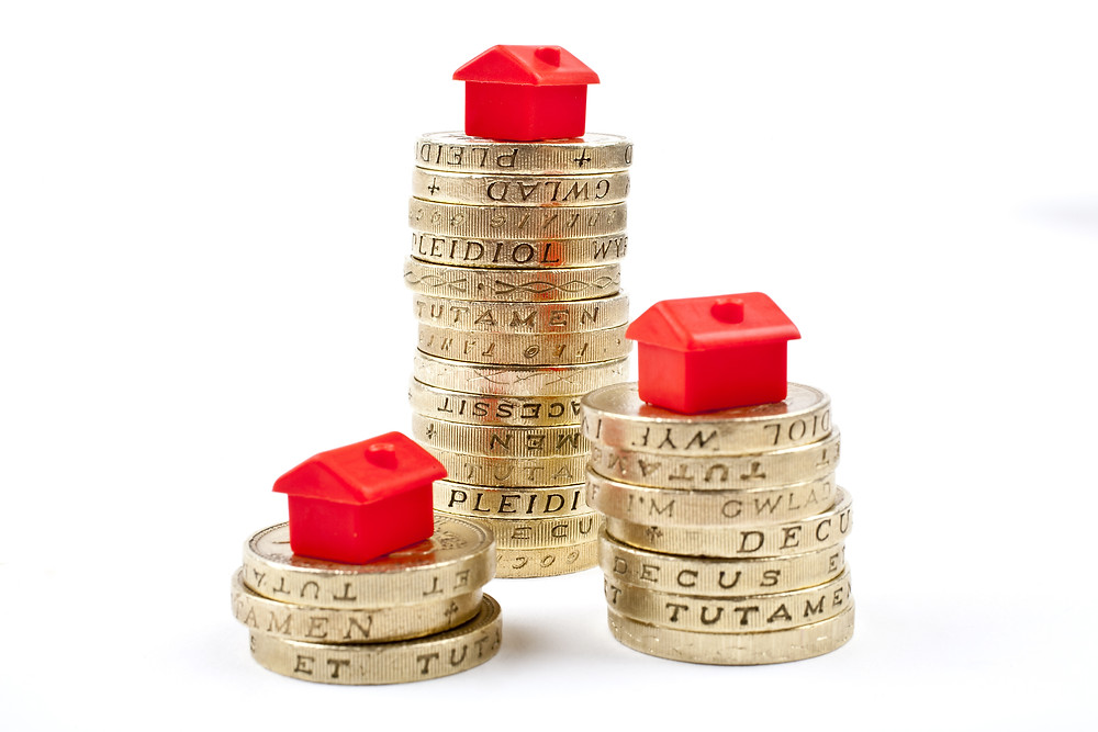 Houses on top of pound coins