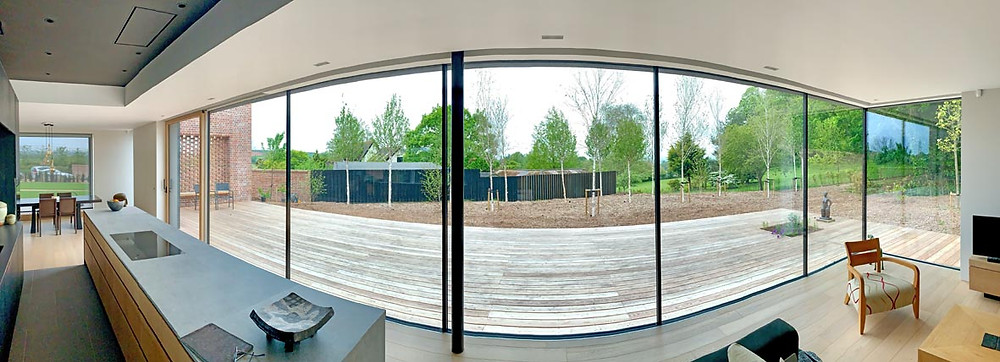 Walled Garden Farringdon (Para 79/55), Design Review Panel Post completion Site Visit - panoramic open plan living space with full height glazing to rear garden