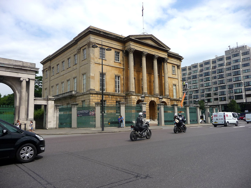 Comparison of the West (left) and South (right) elevations of Apsley House, shows the appeal of rich, warm colour of the copperas decoration to the Bath stone retained in sheltered areas of the South elevation. Note also the context of the house.