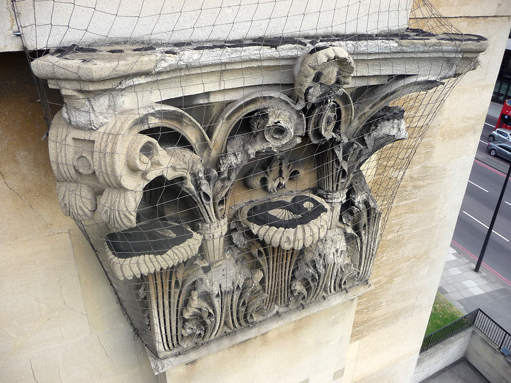 Repairs to the Corinthian capitals of the pilasters carried out using cement