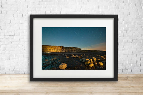 Fine art astrophotography print of stars over Kilve Beach, Somerset - by Arthur Cauty