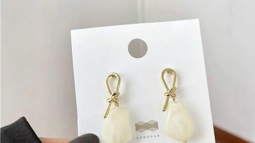 White gem earrings