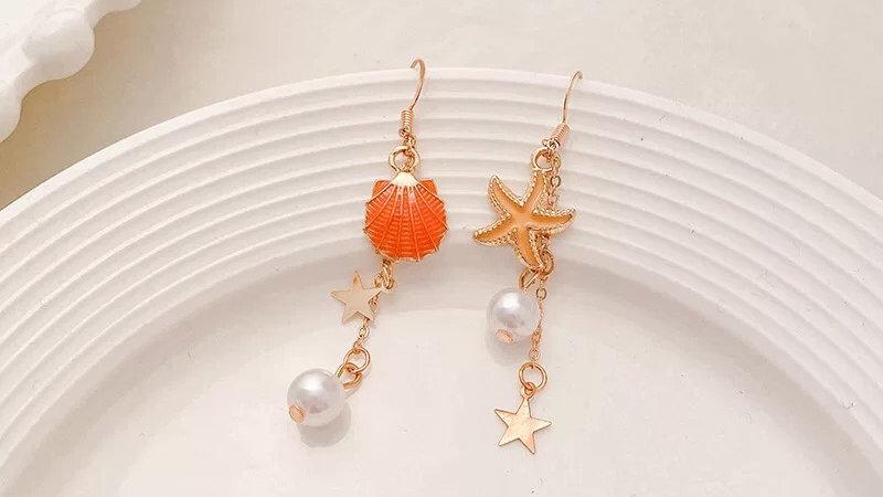 Pink starfish drop earrings