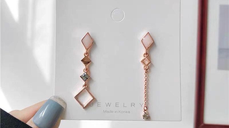 Pink asymmetric earrings
