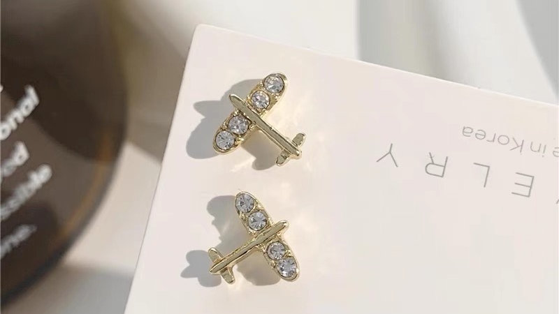 Rhinestone plane earrings