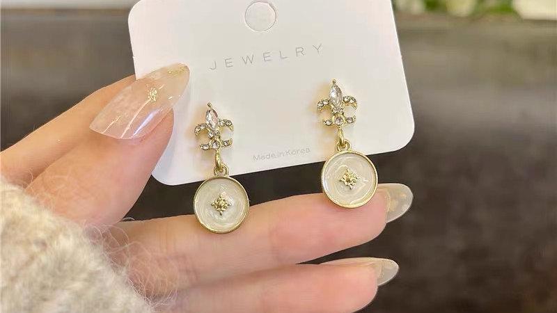 Rhinestone & white earrings