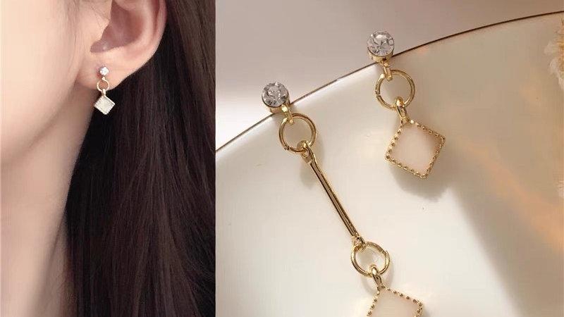 White gem asymmetric earrings