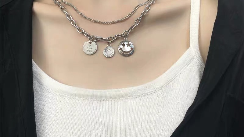 Silver smiley face layered necklace