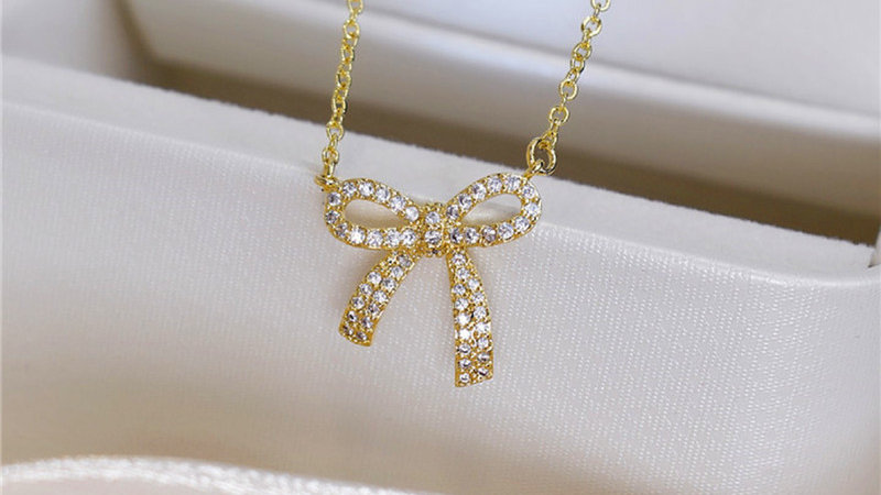 Gold plated bow rhinestone necklace