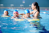 kids swimming with floats.jpg