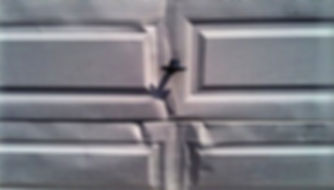 Damaged Garage Door.jpg