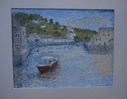 polperro Harbour. Cornwall, moored boat, beautiful old buildings