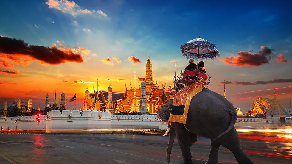 An Elephant with Tourists at Wat Phra Ka