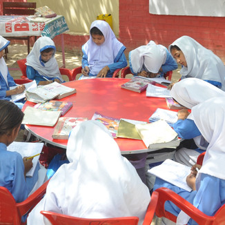 Girls study in open air