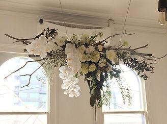 white handing floral arrangement
