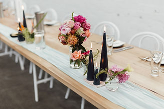 Table styling of bouquets and black triangular candles